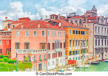 Views of the most beautiful canal of Venice - Grand Canal water streets, boats, gondolas, mansions along. Italy.
