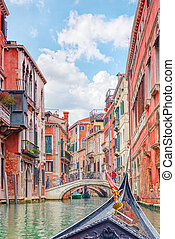 Views of the most beautiful channels of Venice, front of the boat the gondola, floating along the canal. Italy.