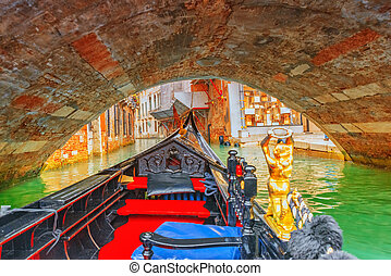 Views of the most beautiful channels of Venice, narrow streets, from the board of the gondola.Italy.
