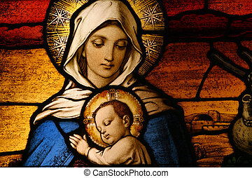 Vigin Mary with baby Jesus - Stained glass depicting the...