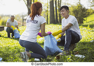 Vigorous two volunteers connecting with nature -...