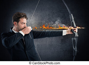 Vigorously hitting the target - Man with bow and arrow on...