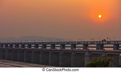 Vijayawada, INDIA - January 7 2019 : Historic Prakasam barrage in twilight, at Vijayawada, India