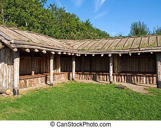 Viking age storage farm house in a village