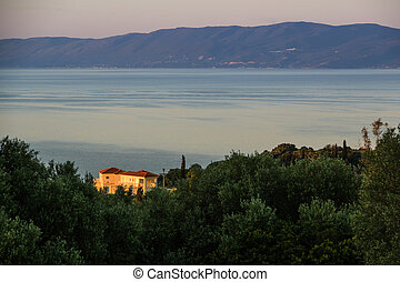 Villa lit by the Greek sunrise