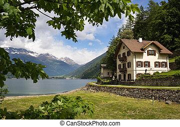 villa near the lake in Swiss Alps
