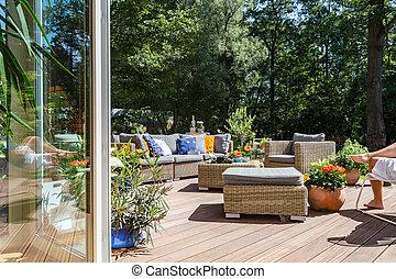Villa terrace with rattan furniture