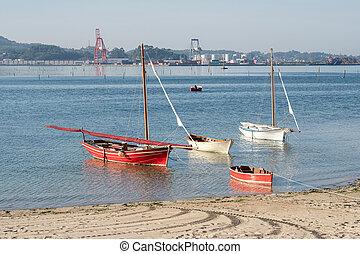 Villagarcia de Arosa, Spain: september 12, 2020: Traditional sailboats anchored on the beach. Old fish boat of Rias Baixas. Villagarcia de Arosa, Galicia, Spain