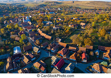 Aerial top drone view of countryside village in Transylvania, Romania