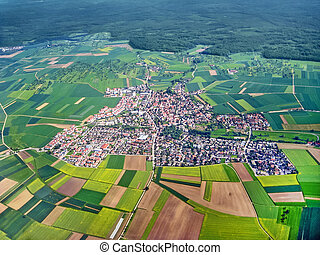 Village aerial view - Typical german village surrounded by ...