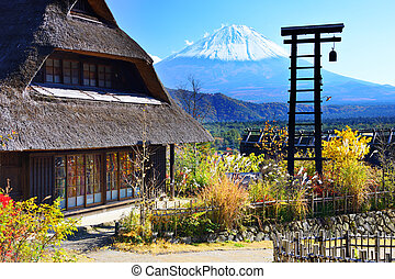 Village and Mt. Fuji - Traditional Japanese huts near Mt....