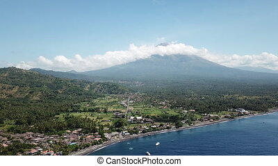 village and sea on the background of volcano agung bali island
