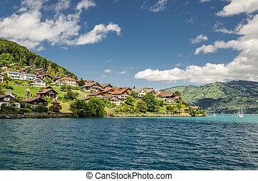 Beautiful village in Thun lake