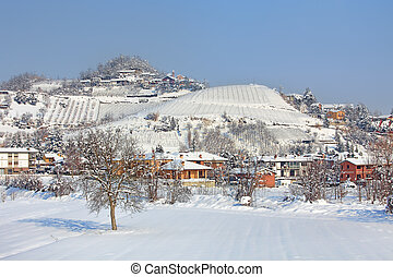 Village covered by snow in Piedmont, Italy.