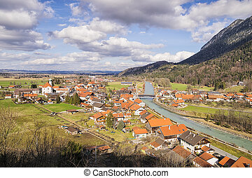 View to the village Eschenlohe with river Loisach and mountains Osterfeuerkopf and Hirschberg in Bavaria, Germany