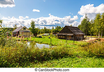 Village house with outbuildings and small pond