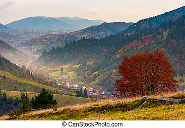 village in a beautiful valley in mountains. hazy autumnal...