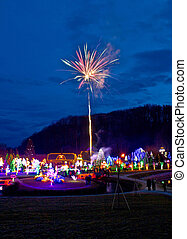 Village in Christmas lights fireworks