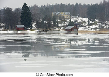village in Finland on the shore of a frozen lake