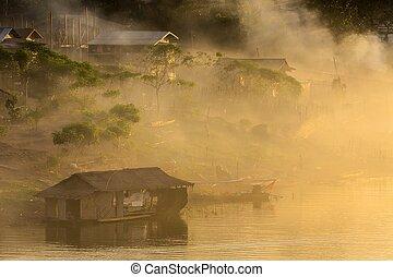 Village in misty dusk