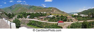 Village in mountains panorama