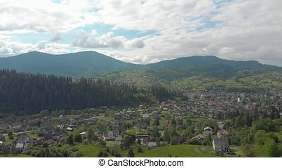 Village in the mountains aerial drone view