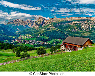 village in the valley of beautiful mountains landscape at summer