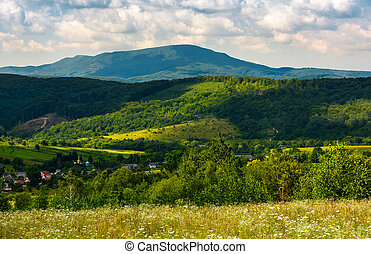 village in the valley of Carpathian mountains. beautiful...