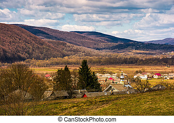 village in valley of Carpathian mountains