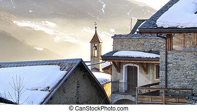village in winter at sunset