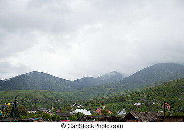 Village landscape with mountains on the background