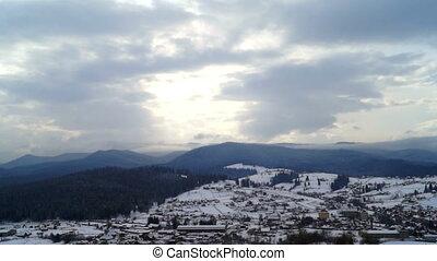 Village mountains clouds