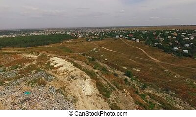 village near a municipal landfill. bird's-eye view. -...