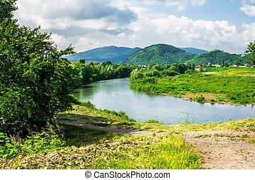 village near mountain river