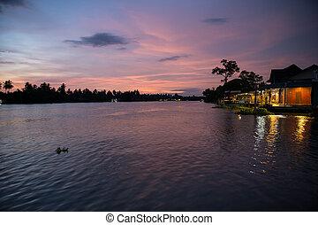 village near river in evening beautiful sunset at Amphawa, ...