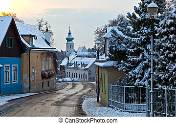 village of Grinzing in early morning light in Wintertime -...