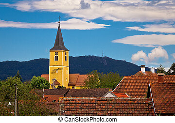 Village of Miholec church tower and Kalnik mountain view,...