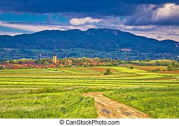 Village of Miholec church tower and Kalnik mountain view,...