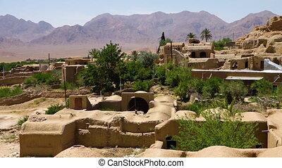 Village on a mountain passage - A panning shot of a village...