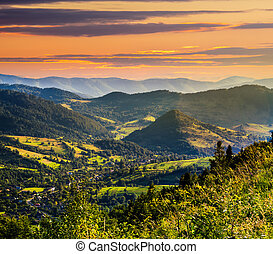 village on hillside meadow - village in mountains behind the...