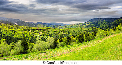 village on mountain slope - panoramic landscape of village...