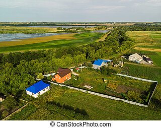 village on shore of pond in Russia