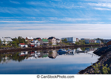 Village on the norwegian island with reflection in water