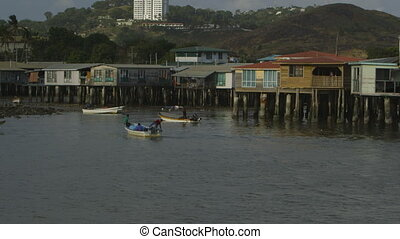 Village residents arriving on canoes, Moresby