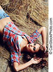 village romance - Seductive young woman in jeans shorts and...