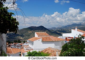 View over village rooftops towards the mountains, Periana, Sierra de Tejeda, Axarquia region, Malaga Province, Andalucia, Spain, Western Europe.