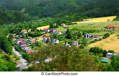 Village tilt shift effect - Beautiful village with houses in...