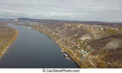 Village town aerial view on river Volga shore at fall