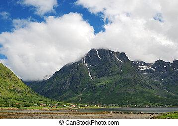 Village under the mountain in summer Lofoten