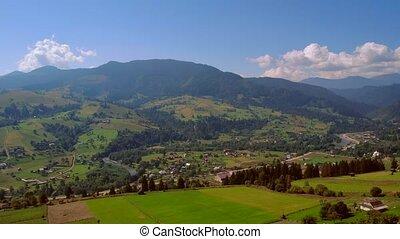 Village valley landscape in Carpathian mountains.